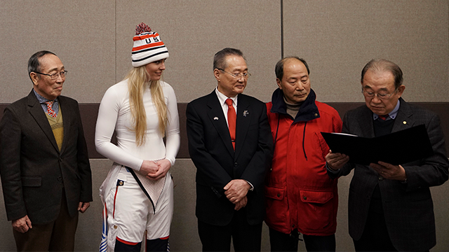 United States' Lindsey Vonn, center, stands next to members of the Yongsan Club, before receiving a letter of appreciation for her grandfather's service during the Korean War in Jeongseon, South Korea, Thursday, Feb. 22, 2018. (AP Photo/Felipe Dana)