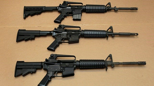 In this photo Aug. 15, 2012 file photo, three variations of the AR-15 assault rifle are displayed. (AP Photo/Rich Pedroncelli, File)