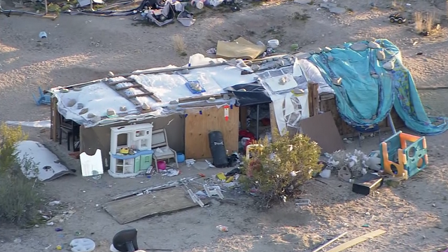 A California couple was arrested for keeping their children in a plywood box on filthy property with no electricity or water. (Source: KABC via CNN)