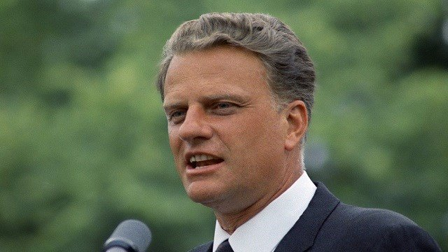 """The Rev. Billy Graham known as """"America's pastor"""" is seen here speaking to an audience in 1967. (AP)"""