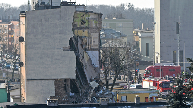 (AP Photo/Str) Rescuers work at a collapsed building in Poznan, Poland, Sunday, March 4, 2018. An apartment block collapsed Sunday in Poland's western city of Poznan, killing several people and injuring more than 20 others, officials said as teams of...