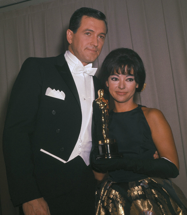 Actors Rita Moreno and Rock Hudson are pictured at the Academy Awards in Santa Monica, Calif., April 9, 1962. (AP Photo)