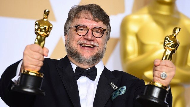 "Guillermo del Toro, winner of the awards for best director and best picture for ""The Shape of Water,"" poses in the press room at the Oscars on Sunday, March 4, 2018, at the Dolby Theatre in Los Angeles. (Photo by Jordan Strauss/Invision/AP)"
