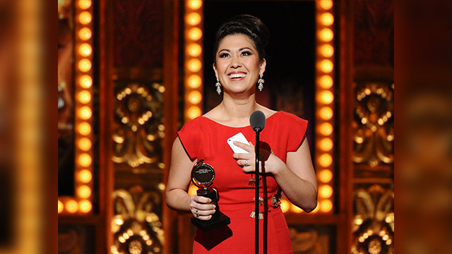 "Ruthie Ann Miles accepts the award for best performance by an actress in a featured role in a musical for ""The King & I"" at the 69th annual Tony Awards at Radio City Music Hall on Sunday, June 7, 2015, in New York. (Photo by Charles Sykes/Invision/AP)"