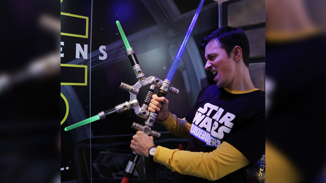In this Saturday, Feb. 14, 2015, file photo, Jeff Wolf demonstrates the Star Wars Bladebuilders Jedi Master Lightsaber at the Hasbro showroom at the North American International Toy Fair. (AP Photo/Mark Lennihan, File)