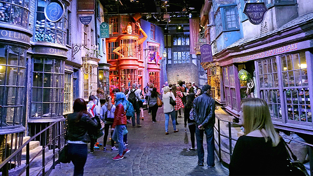 (AP) Tourists stroll along the Diagon Alley movie set at The Making of Harry Potter Warner Bros. Studios experience in London. Visitors can view props, costumes and sets, including Platform 9 ¾, the Night Bus, Harry's cubbyhole at Number 4 Privet Drive .