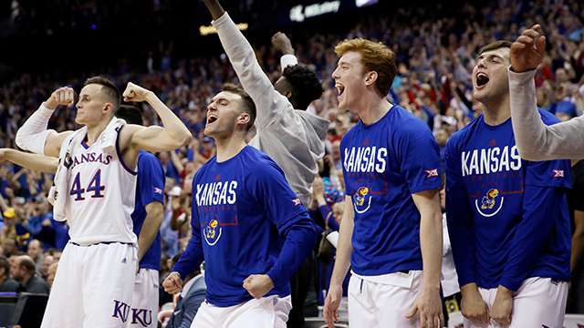 Kansas players celebrate during the second half of the NCAA college basketball championship game against West Virginia in the Big 12 men's tournament Saturday, March 10, 2018, in Kansas City, Mo. Kansas won 81-70. (AP Photo/Charlie Riedel)