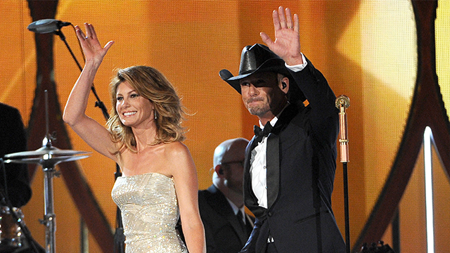 Faith Hill, left, and Tim McGraw walk on stage at the 49th annual Academy of Country Music Awards at the MGM Grand Garden Arena on Sunday, April 6, 2014, in Las Vegas. (Photo by Chris Pizzello/Invision/AP)