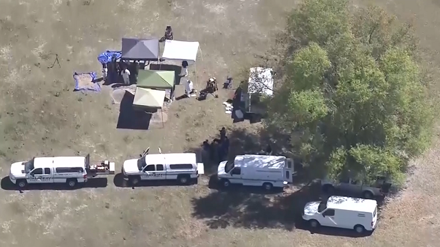 This aerial photo shows police searching the backyard of Michael Shaver, a Disney monorail mechanic whose been missing since 2015. (WESH via CNN)