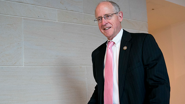 (AP Photo/Andrew Harnik) n this March 8, 2018, photo, Rep. Mike Conaway, R-Texas, left, at the Capitol in Washington. Republicans on the House intelligence committee have completed a draft report concluding there was no collusion or coordination between..