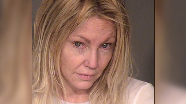 (Ventura County Sheriff's Office via AP) This undated booking photo provided by the Ventura County Sheriff's Office shows actress Heather Locklear. Locklear was arrested for investigation of domestic violence and fighting with sheriff's deputies...