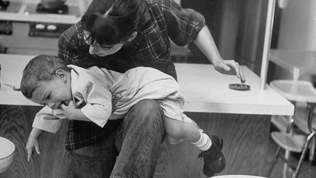 Baby sitter Judy Fuss acting out giving her young charge a spanking but believes like most trained sitters that there are better ways of discipling children. (Photo by Leonard Mccombe/The LIFE Picture Collection/Getty Images)