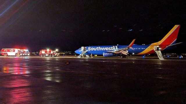 In this Sunday, March 11, 2018 photo, Southwest aircraft flight 3562 sits on the tarmac after making an emergency landing at Albuquerque International Sunport in Albuquerque, Ariz. (David Fleck via AP)