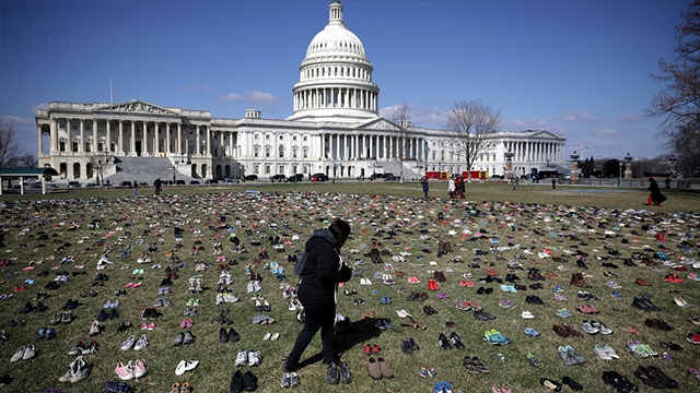 (Chip Somodevilla/Getty Images) Seven thousand pairs of shoes, representing the children killed by gun violence since the mass shooting at Sandy Hook Elementary School in 2012, are spread out on the lawn on the east side of the US Capitol on Tuesday...