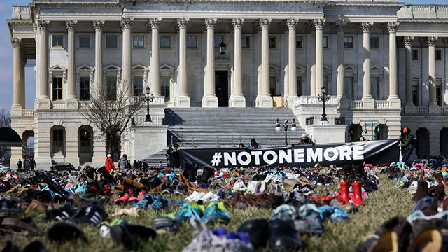 (Photo by Chip Somodevilla/Getty Images) Seven thousand pairs of shoes, representing the children killed by gun violence since the mass shooting at Sandy Hook Elementary School in 2012, are spread out on the lawn on the east side of the U.S. Capitol.