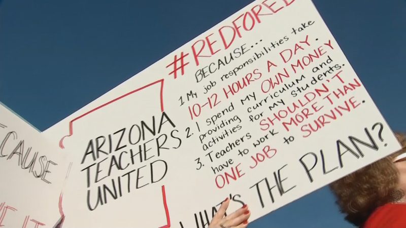 Gov. Doug Ducey was met by protesting teachers on Monday outside the KTAR studio where he gave an interview. (Source: 3TV/CBS 5)