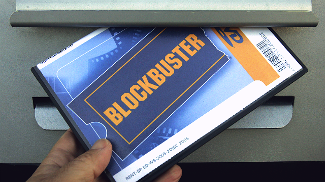 A customer returns a DVD to the Blockbuster store Thursday morning, April 27, 2006 in Columbus, Ind. (AP Photo/Darron Cummings)