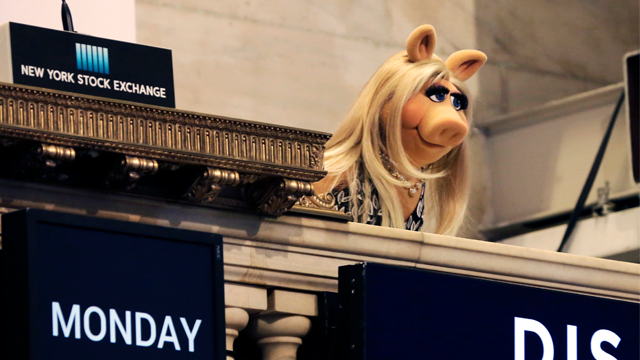 "In this Monday, Feb. 1, 2016, file photo, Miss Piggy overlooks the New York Stock Exchange trading floor after ringing the opening bell to highlight Disney's ""The Muppets"" television show. (AP Photo/Richard Drew, File)"