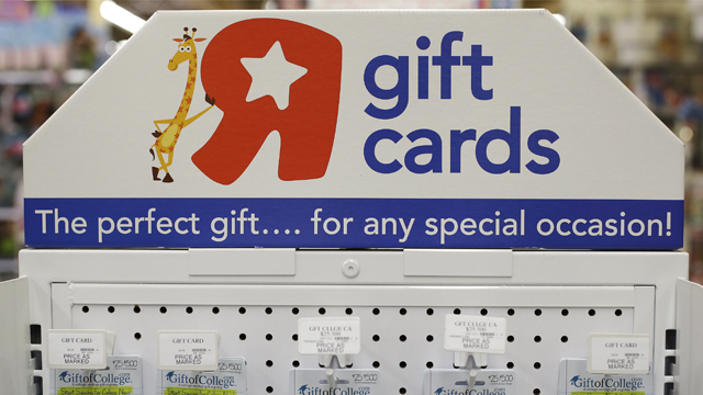 In this Nov. 22, 2016 photo, Gift of College gift cards are on diplay at Toys R Us in Emeryville, Calif. (AP Photo/Ben Margot)