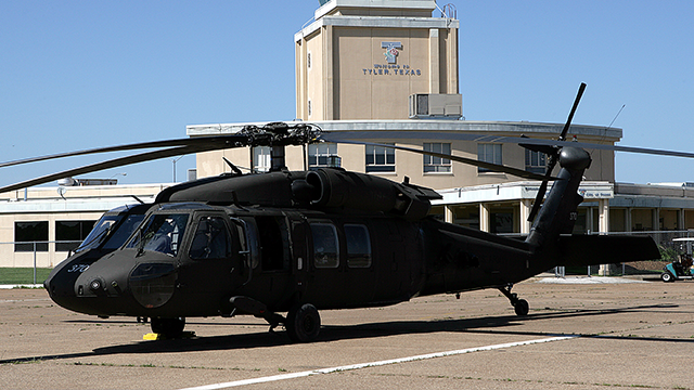 (AP Photo/Dr. Scott M. Lieberman)  Blackhawk Helicopter of the 1-244 Attack Helicopter Battalion of the La. National Guard in seen front of the control tower at Pound's Field in Tyler, Texas, on Saturday, April 19, 2008.