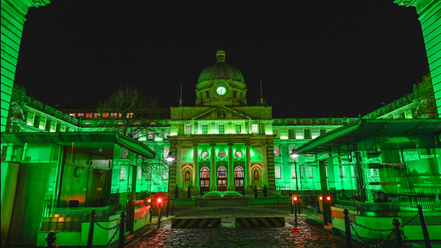 The Irish Government Buildings in Dublin go green on the eve of St Patrick's Day. On Thursday, March 16, 2017, in Dublin, Ireland.  (Photo by Artur Widak/NurPhoto via Getty Images)