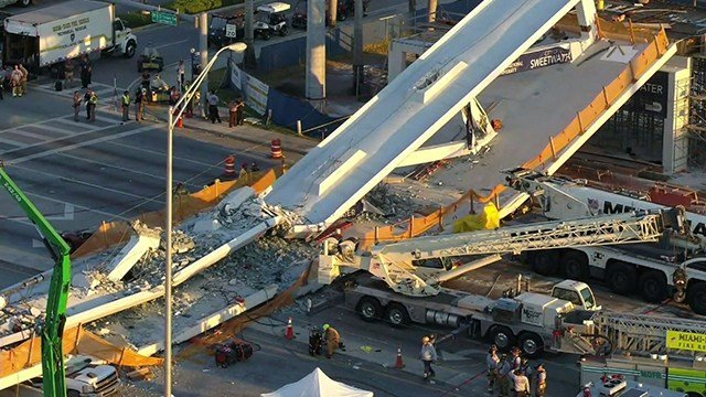 Drone captures scene where a pedestrian bridge collapsed at Florida International University in Miami. (CNN)