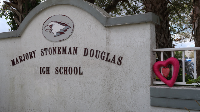 A memorial is set up at Marjory Stoneman Douglas High days after a shooting took place at the school located in Parkland, Florida. (Devon Sayers/CNN)