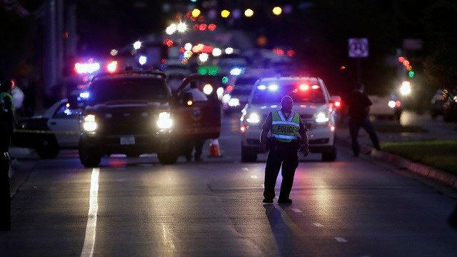 In this file photo, emergency vehicles stage near the site of another explosion, Tuesday, March 20, 2018, in Austin, Texas. (AP Photo/Eric Gay)