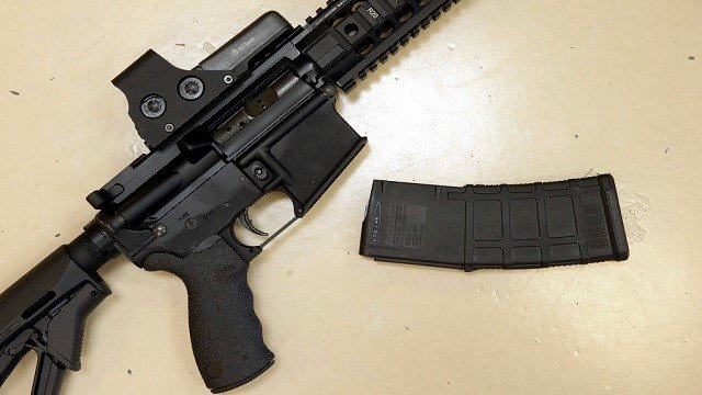 This Oct. 3, 2013 file photo shows a custom-made semi-automatic hunting rifle with a high-capacity detachable magazine. (AP Photo/Rich Pedroncelli, file)