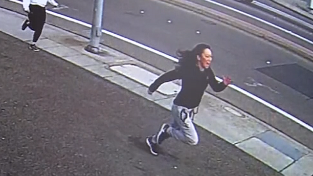Hannie Dong chases the suspect who grabbed her laptop and ran. (Source: KGO via CNN)
