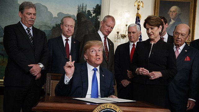 Trump signs $1.3T budget after threatening veto