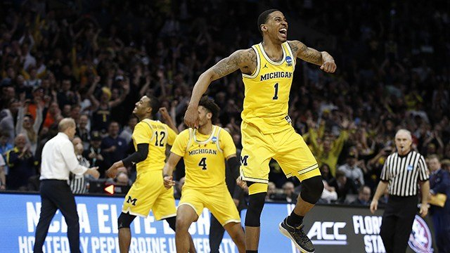 Michigan guard Charles Matthews (1), guard Muhammad-Ali Abdur-Rahkman (12) and forward Isaiah Livers (4) celebrate after Michigan defeated Florida State 58-54. (AP Photo/Alex Gallardo)