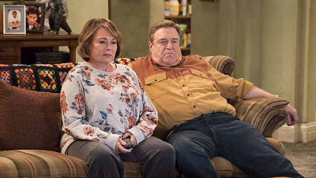 "In this image released by ABC, Roseanne Barr, left, and John Goodman appear in a scene from the reboot of ""Roseanne."" (Adam Rose/ABC via AP, File)"