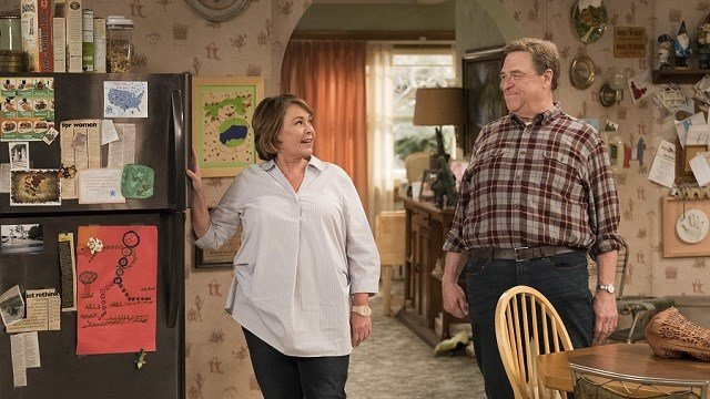 "This image released by ABC shows Roseanne Barr, left, and John Goodman in a scene from the comedy series ""Roseanne."" (Adam Rose/ABC via AP, File)"