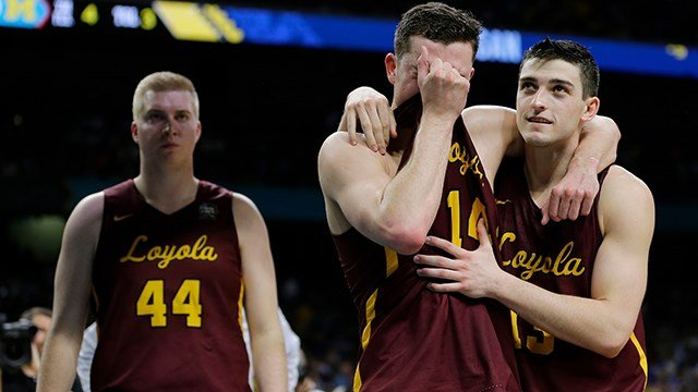 Loyola-Chicago's Ben Richardson embraces with Clayton Custer, right, after the semifinals of the Final Four NCAA college basketball tournament against Michigan, Saturday, March 31, 2018, in San Antonio. Michigan won 69-57. (AP Photo/David J. Phillip)