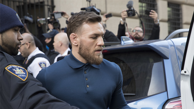 Ultimate fighting star Conor McGregor heads to a vehicle to leave Brooklyn Criminal Court, Friday, April 6, 2018 in New York. (AP Photo/Mary Altaffer)