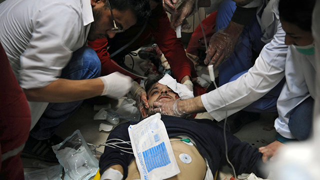 (SANA via AP) In this photo released by the Syrian official news agency SANA, shows a man receiving treatment at a hospital in Damascus, Syria, Saturday, April. 7, 2018.