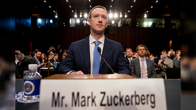 Facebook CEO Mark Zuckerberg arrives to testify before a joint hearing of the Commerce and Judiciary Committees on Capitol Hill in Washington, Tuesday, April 10, 2018, about the use of Facebook data to target American voters in the 2016 election. (AP)