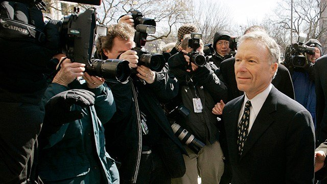 "Former White House aide I. Lewis ""Scooter"" Libby walks past a line of photographers as he prepares to give a news conference outside federal court in this March 6, 2007, file photo.  (AP Photo/Gerald Herbert/FILE)"
