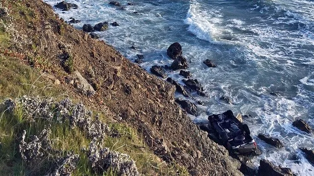 The family's SUV plunged about 100 feet off a cliff along Highway 1, killing all of the vehicle's occupants. (California Highway Patrol)