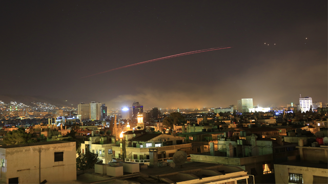 Damascus skies erupt with anti-aircraft fire as the U.S. launches an attack on Syria targeting different parts of the Syrian capital Damascus, Syria, early Saturday, April 14, 2018.  (AP Photo/Hassan Ammar)