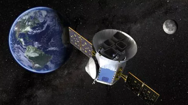 (NASA via AP). This image made available by NASA shows an illustration of the Transiting Exoplanet Survey Satellite (TESS). Scheduled for an April 2018 launch, the spacecraft will prowl for planets around the closest, brightest stars. These newfound wo...