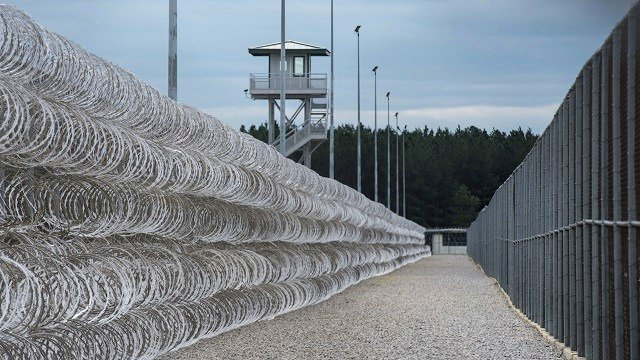 In this Feb. 9, 2016, file photo, razor wire protects a perimeter of the Lee Correctional Institution in Bishopville, S.C. (AP Photo/Sean Rayford, File)