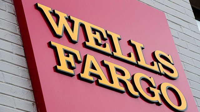 This Aug. 11, 2017, file photo shows a sign at a Wells Fargo bank location in Philadelphia.(AP Photo/Matt Rourke, File)