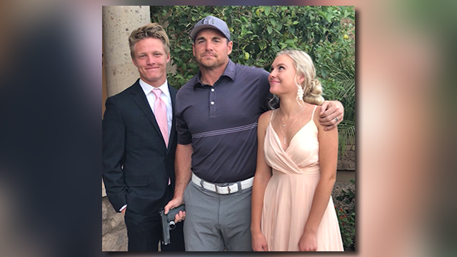 Jay Feely says a photo showing him holding a gun next to his daughter's prom date was a joke. (Source: Jay Feely, Twitter via CNN)