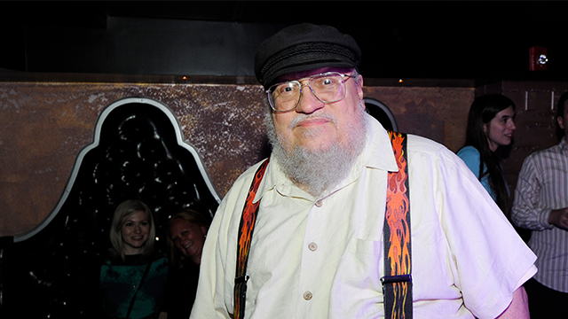 Game of Thrones author George RR Martin, center, is seen at the 3rd Annual KINGS OF CON party, on Thursday, July 18, 2013, in San Diego, Calif. (Photo by Jack Dempsey/Invision for KINGS OF CON/AP Images)
