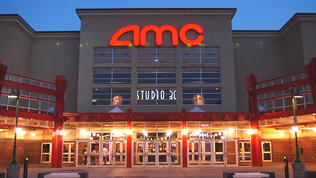 n this May 11,2005 file photo, people enter AMC's Studio 30 theater in Olathe, Kan. (AP Photo/Orlin Wagner)