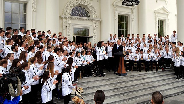 Olympians applaud as President Donald Trump speaks welcoming the Team USA Olympic athletes on North Portico at the White House in Washington Friday