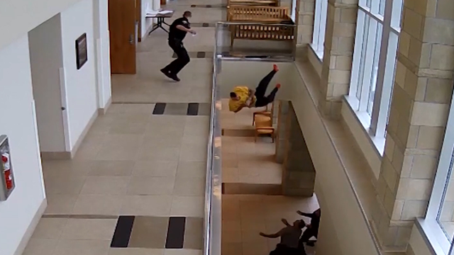 Handcuffed man tries to flee courthouse, nosedives over balcony