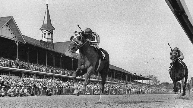 Secretariat, with jockey Ron Turcotte, runs at Churchill Downs during the 99th Kentucky Derby in Louisville on May 5, 1973. Secretariat is the 9th horse to win the Triple Crown and holds the record for each of the three races. (AP Photo)